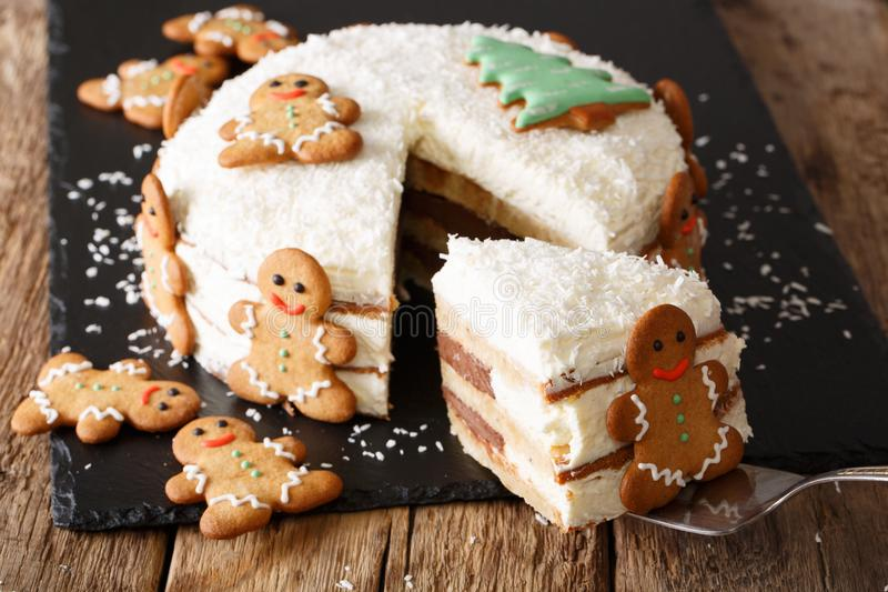 piece of Christmas cake with cheese cream is decorated with gingerbread close-up. horizontal stock image