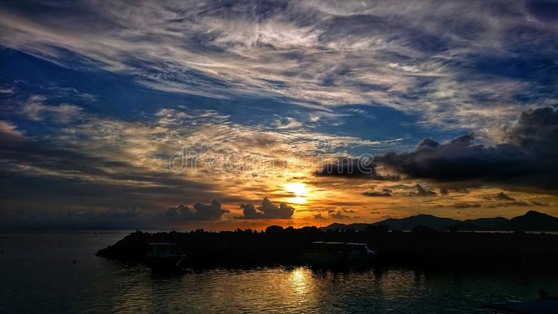 A piece of cloud cake in the sunset. location La Digue Seychelles.  royalty free stock photography