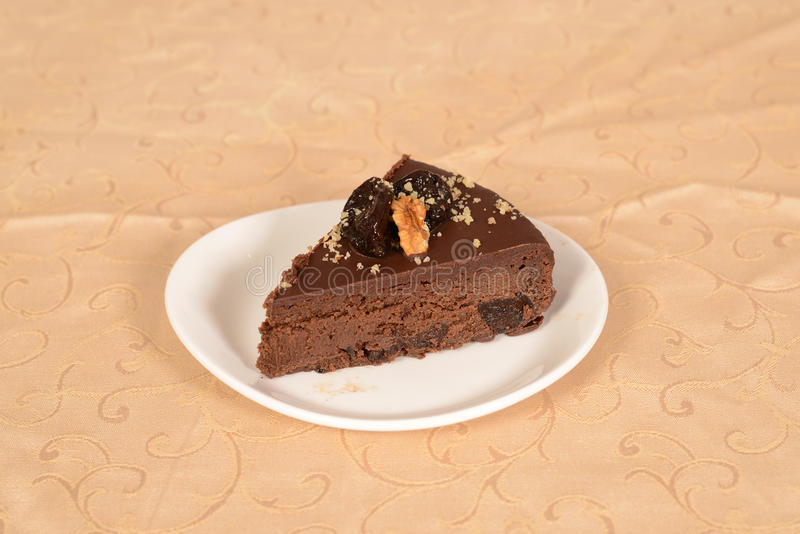 Piece of cocao pie with whole nuts stock image