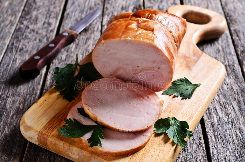 Piece of cooked ham. On a wooden surface. Selective focus stock photo