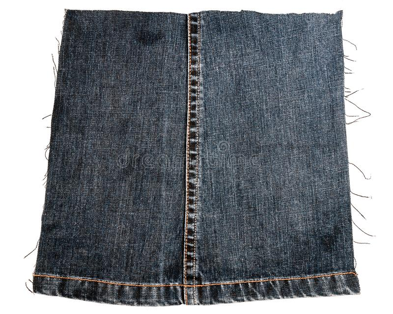Piece of dark jeans fabric stock image
