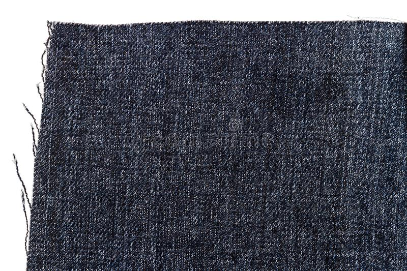 Piece of dark jeans fabric royalty free stock photos