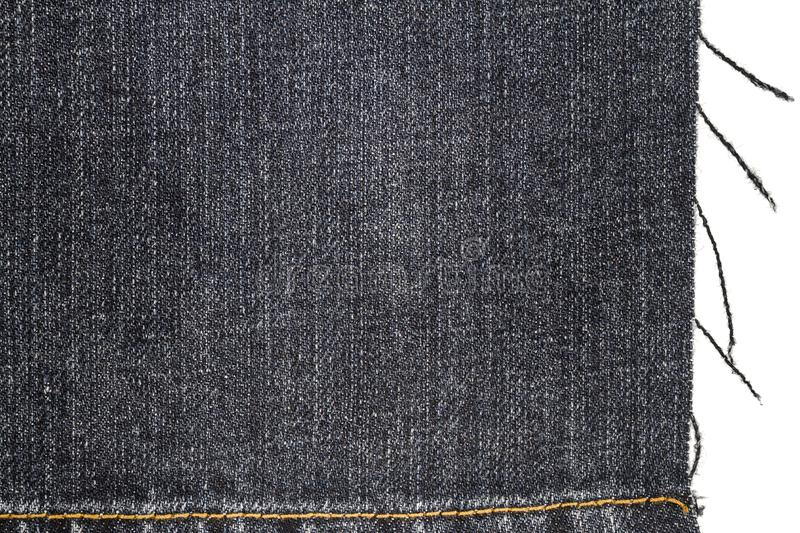 Piece of dark jeans fabric stock images