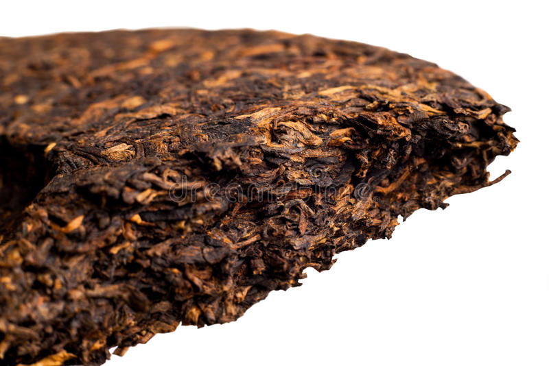 Piece of delicious ripe Puer tea Chinese. Famous and useful pressed ripe Puer tea in Chinese cake closeup royalty free stock images