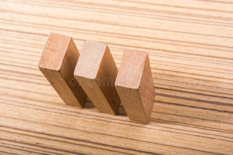 Piece of domino made of wood on wooden texture. Piece of domino elements made of wood on wooden texture stock photos