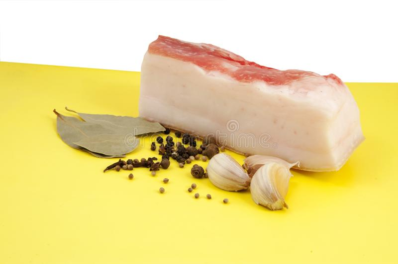 Piece of fresh lard with spices royalty free stock photography