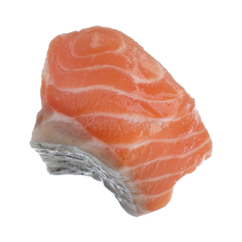 Piece of fresh raw salmon isolated on white. Fish delicacy. Piece of fresh raw salmon isolated on white royalty free stock images