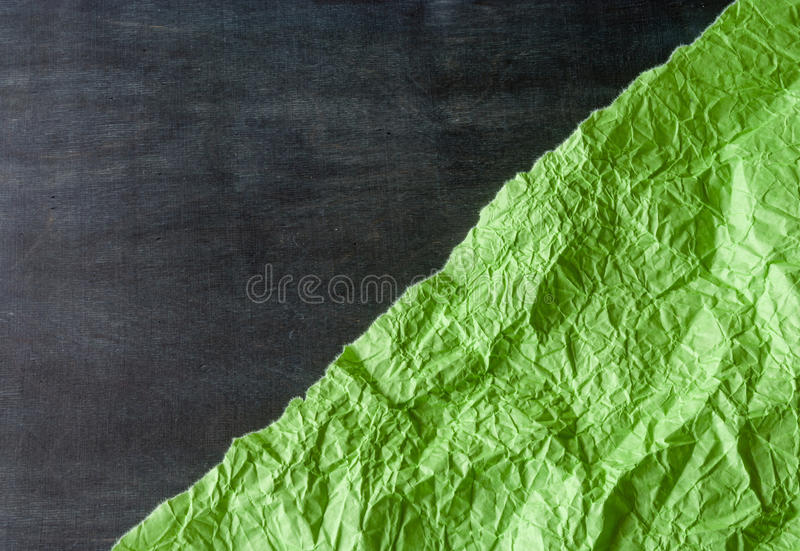 Download Piece Of Green Paper Torn Positioned Diagonally Against The Dark Wood. Stock Photo - Image: 83720422