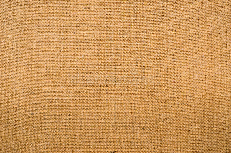 Piece of hessian fabric showing the woven pattern and texture. Piece of beige hessian fabric showing the woven pattern and texture royalty free stock image