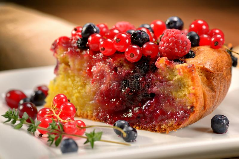 Piece of home-cooked tasty pie with raspberry blueberry currant cranberry stock photos