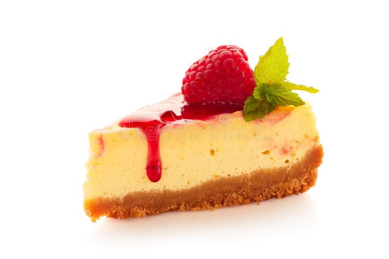 Piece of homemade cheesecake decorated with raspberries and mint on white stock image