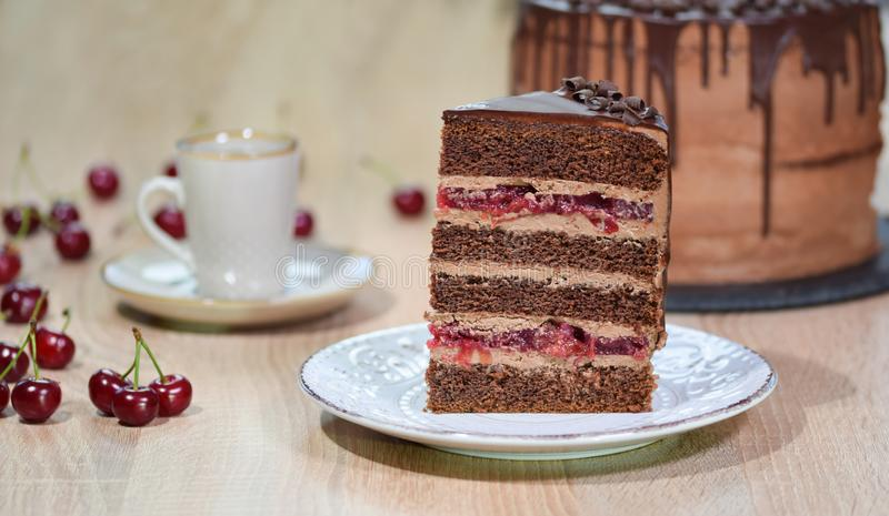 Piece of homemade cherry cake with chocolate cream royalty free stock photo