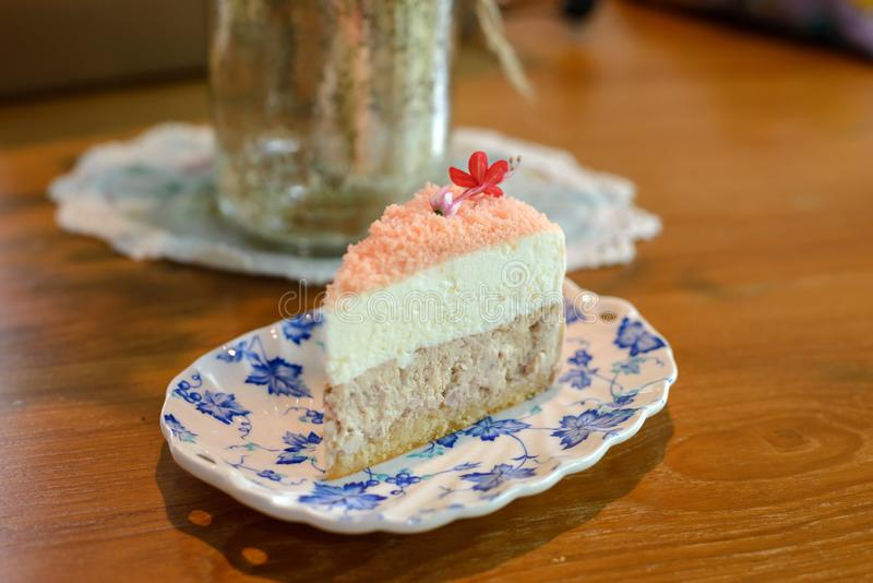 Piece of homemade taro cake in classic plate on table with copy space royalty free stock photography