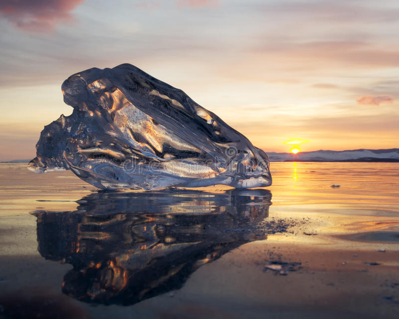 A piece of ice lying on the frozen surface of lake Baikal. At dawn stock image