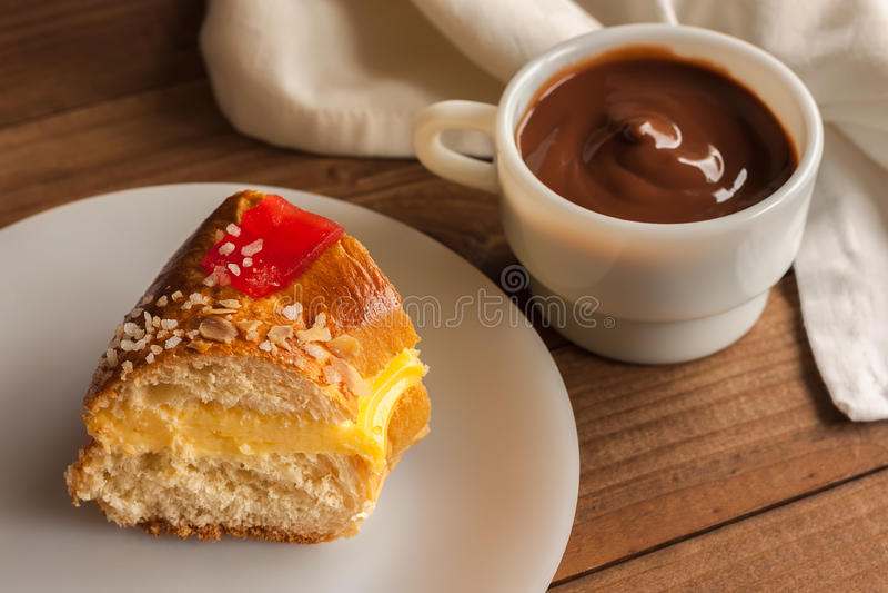 Piece of Kings cake Roscon de Reyes stock photos
