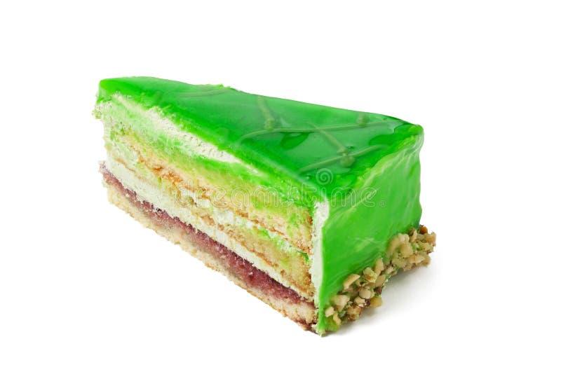 Piece of kiwi cake isolated on white background. Clouseup view stock photo