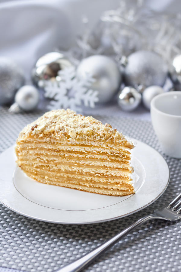 Download Piece Of Layer Cake With Custard And Walnuts On A Plate Stock Image - Image: 83707443