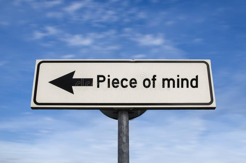 Piece of mind white road sign with arrow, arrow on blue sky background. Road sign, arrow on blue sky background. One way blank road sign. Arrow on a pole stock photos