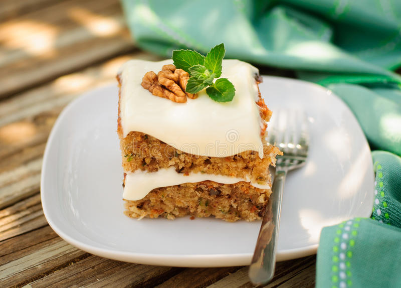 A Piece of Moist Zucchini and Walnut Cake with Cream Cheese Frosting. Copy space for your text royalty free stock photos