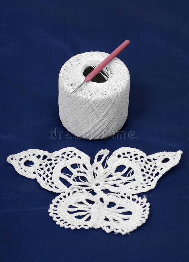 Piece of needlework near clue with crochet hook. stock image