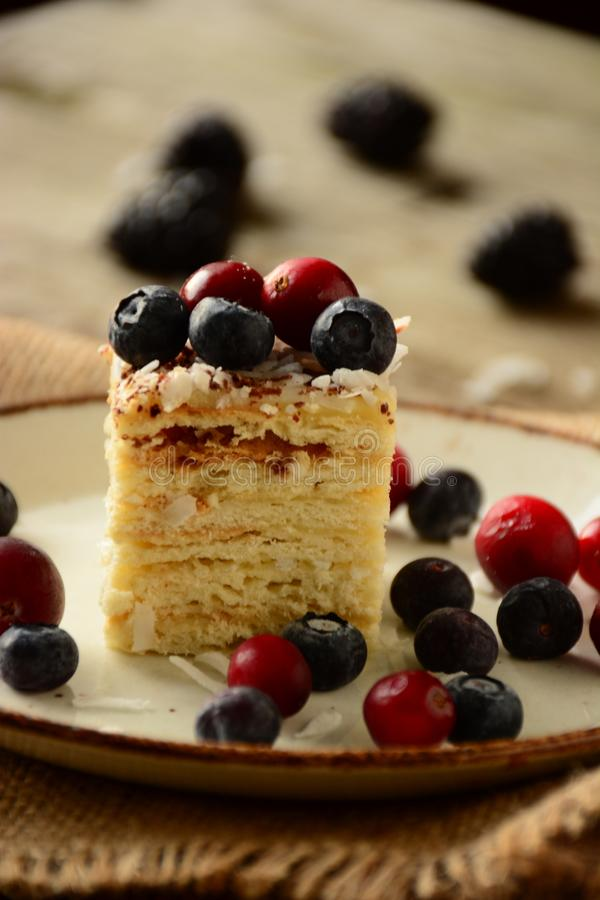 Free Piece Of Cake Napoleon On A Plate With Sweet Fresh Berries Royalty Free Stock Image - 108922516