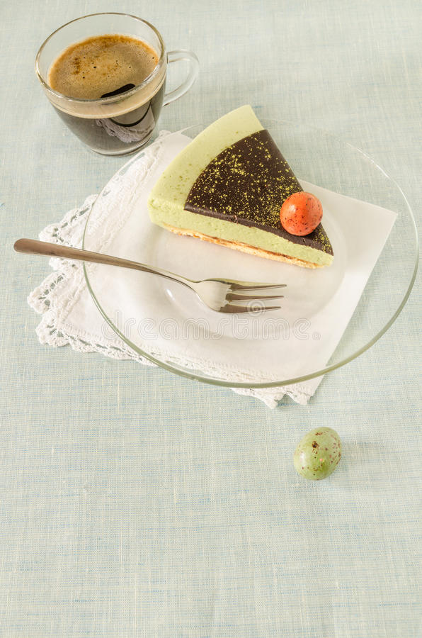 Free Piece Of Easter Cake With Tea Matcha Decorated Chocolate Ganache And Sweet-stuff Eggs On Glass Plate Royalty Free Stock Photo - 49803365