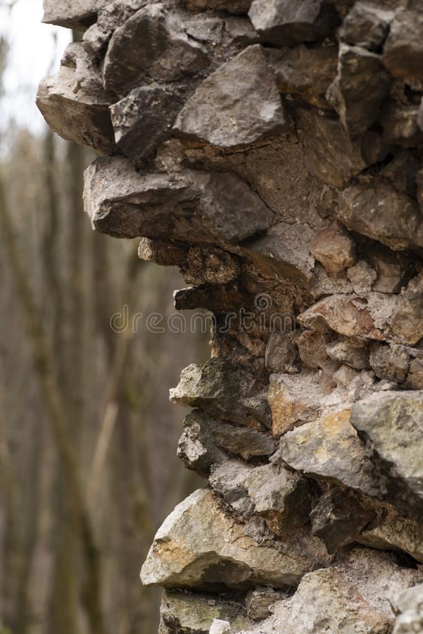 A piece of old destroyed walls of the fortress. Fragment of the old fortress wall. royalty free stock photography