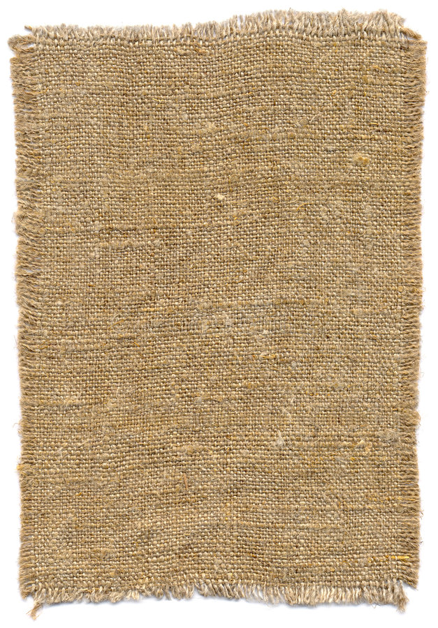 Piece of old sackcloth. Piece of old handmade rough sackcloth on white royalty free stock photography