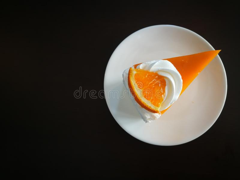 A piece of orange cake royalty free stock photography