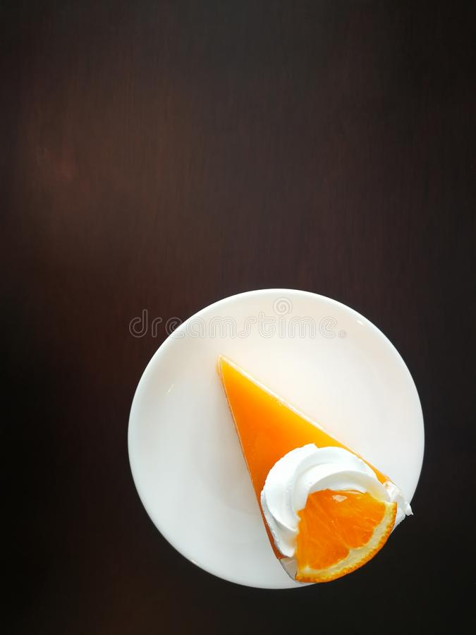 A piece of orange cake royalty free stock images