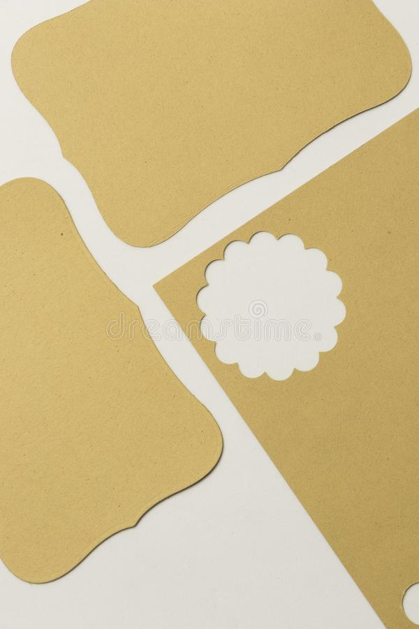 Piece of paper for scrapbook in yellow with cropped flower figure. Textured gold yellow paper stock photography