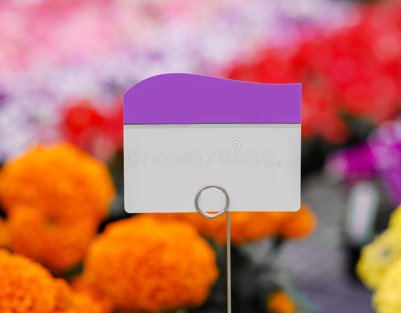 Piece of paper, tag or label with colorful flowers background stock images