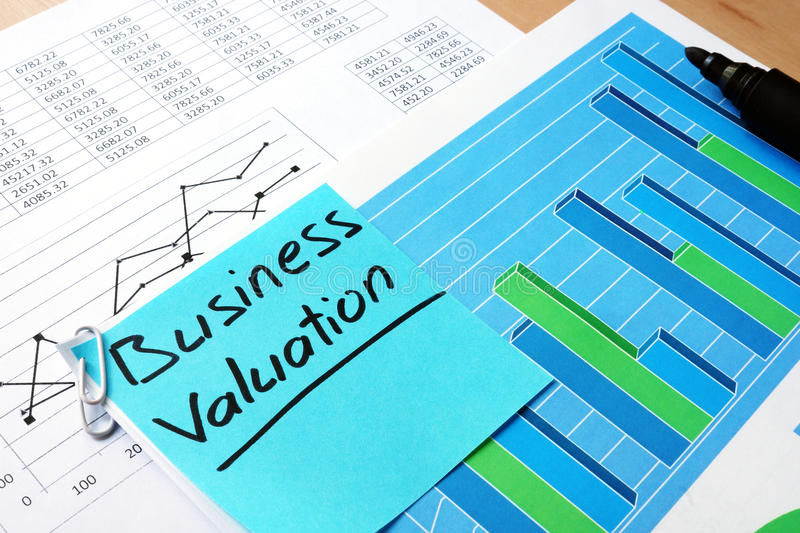 Piece of paper with words business valuation. stock photos