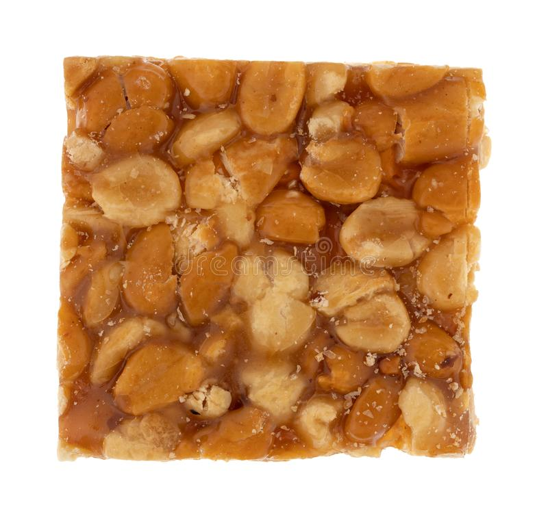 Piece of peanut crunch candy isolated on a white background stock photo