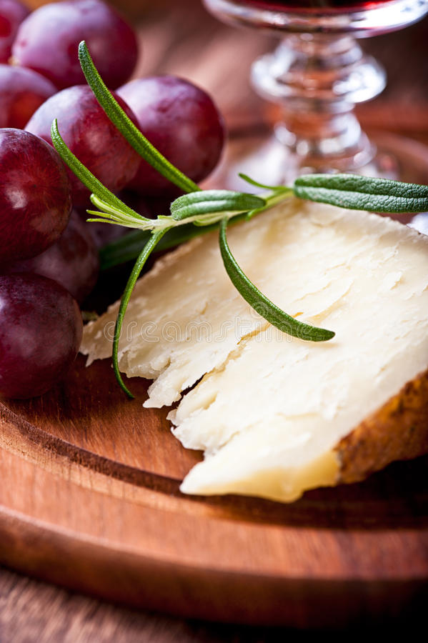 Piece of Pecorino and red Grapes royalty free stock photo