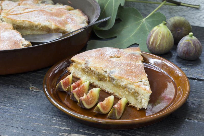 Piece of pie with figs stock images