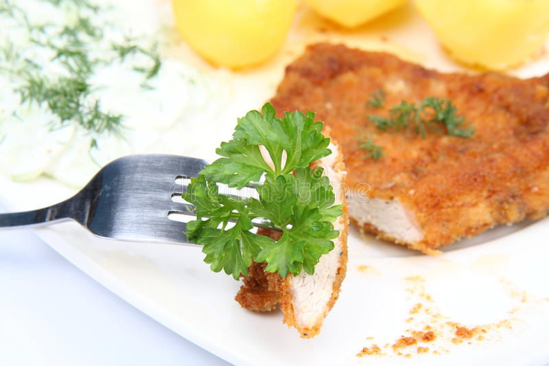 Piece Of Pork Chop On A Fork Stock Image