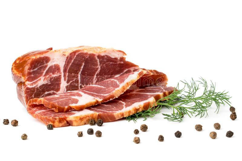 A piece of pork neck meat sliced with black pepper and dill leaves on white background. stock photo