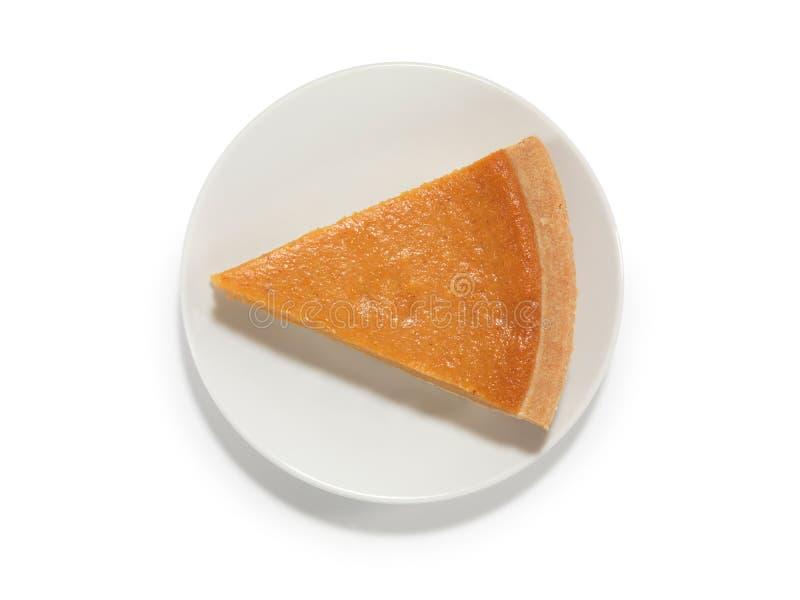 Piece of Pumpkin Pie on a Saucer royalty free stock photos