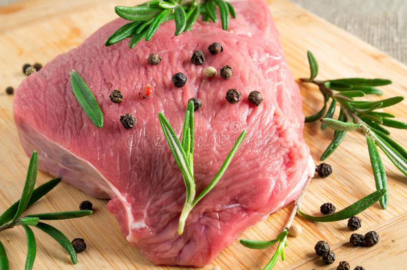 Download Piece Of Raw Beef With Rosemary Stock Photo - Image: 83717779