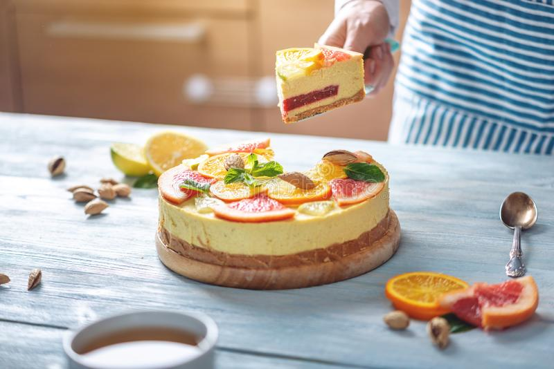 A piece of raw citrus cake with grapefruit, orange, lime and lemon. Healthy fresh summer dessert. Homemade vegan food stock image