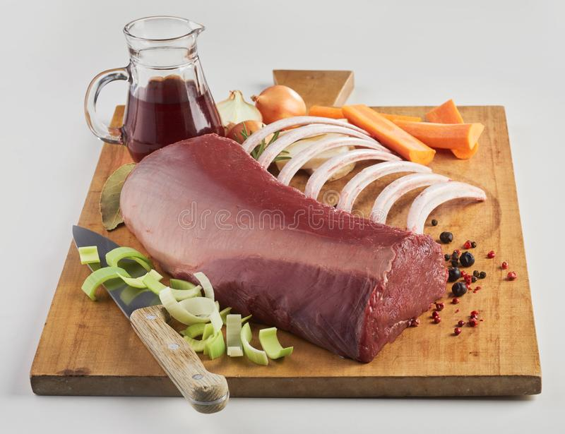 Piece of raw meat and vegetables royalty free stock images