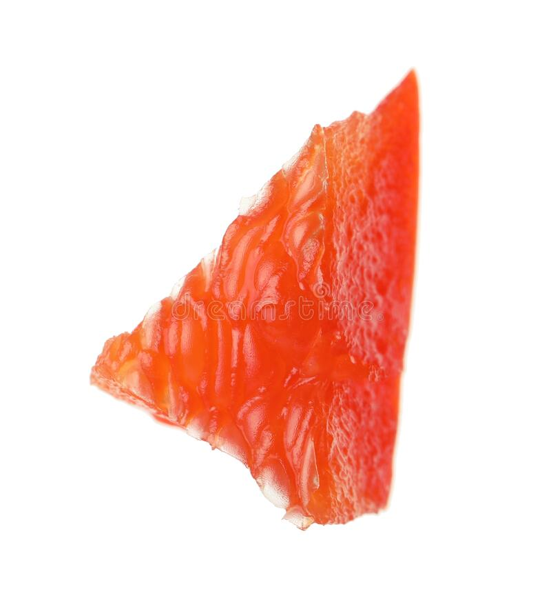 Piece of red bell pepper isolated. On white stock photos