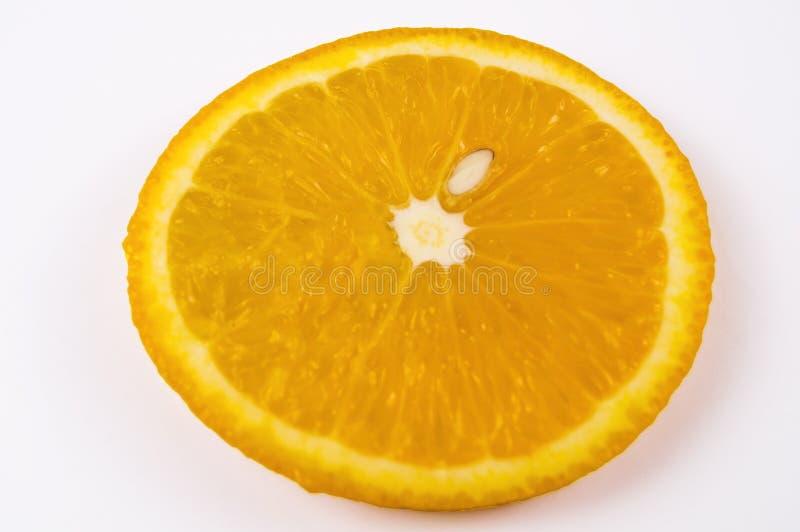 A piece of ripe orange orange on a light background stock photography