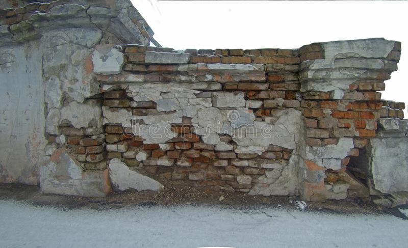 Piece of a ruined brick old wall royalty free stock photography
