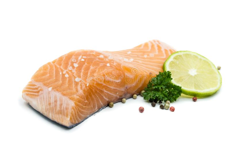 Piece of salmon fillet isolated on white background stock photo