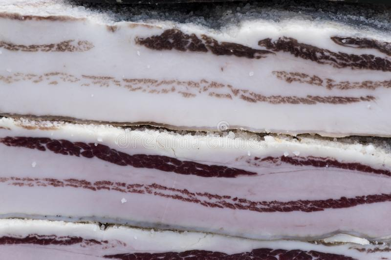 Salty bacon. Piece of salted bacon stock photo
