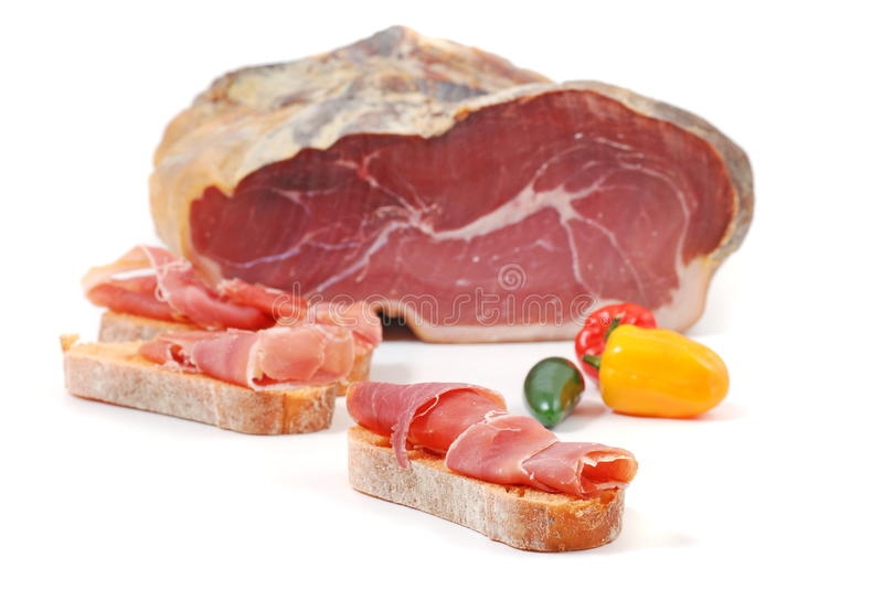 Piece of serrano ham. With paprika royalty free stock images