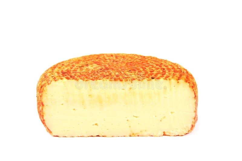 Piece of smoked cheese stock photo