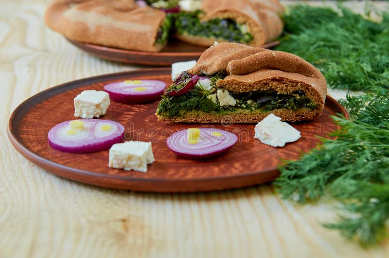 Download A Piece Of Spinach Pie With Feta Cheese Onion On The Clay Brown Plate & A Piece Of Spinach Pie With Feta Cheese Onion On The Clay Brown ...